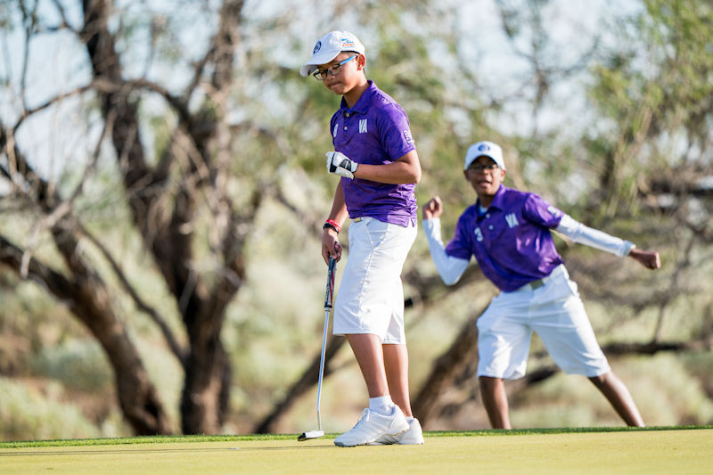 SCOTTSDALE, AZ - NOVEMBER 17:  Seth Neou (8) and teammate Elijah Selby (3) of Team Virginia celebrate a birdie putt at the seventh hole during the second session of the 2018 PGA Jr. League Championship presented by National Car Rental held at Grayhawk Golf Club in Scottsdale, Arizona on November 17, 2018. (Photo by Darren Carroll/PGA of America)